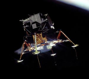 1280px-Apollo_11_Lunar_Module_Eagle_in_landing_configuration_in_lunar_orbit_from_the_Command_and_Service_Module_Columbia